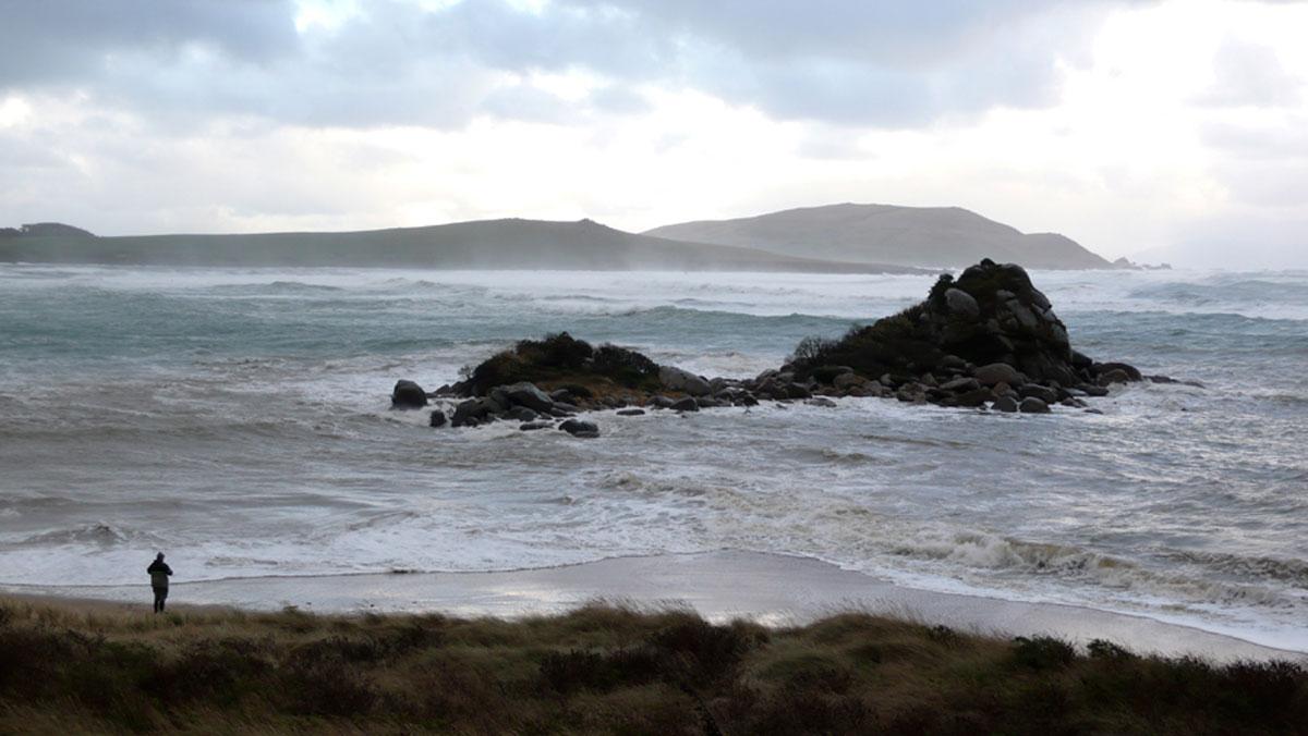 Beach and Pene Rock in stormy seas