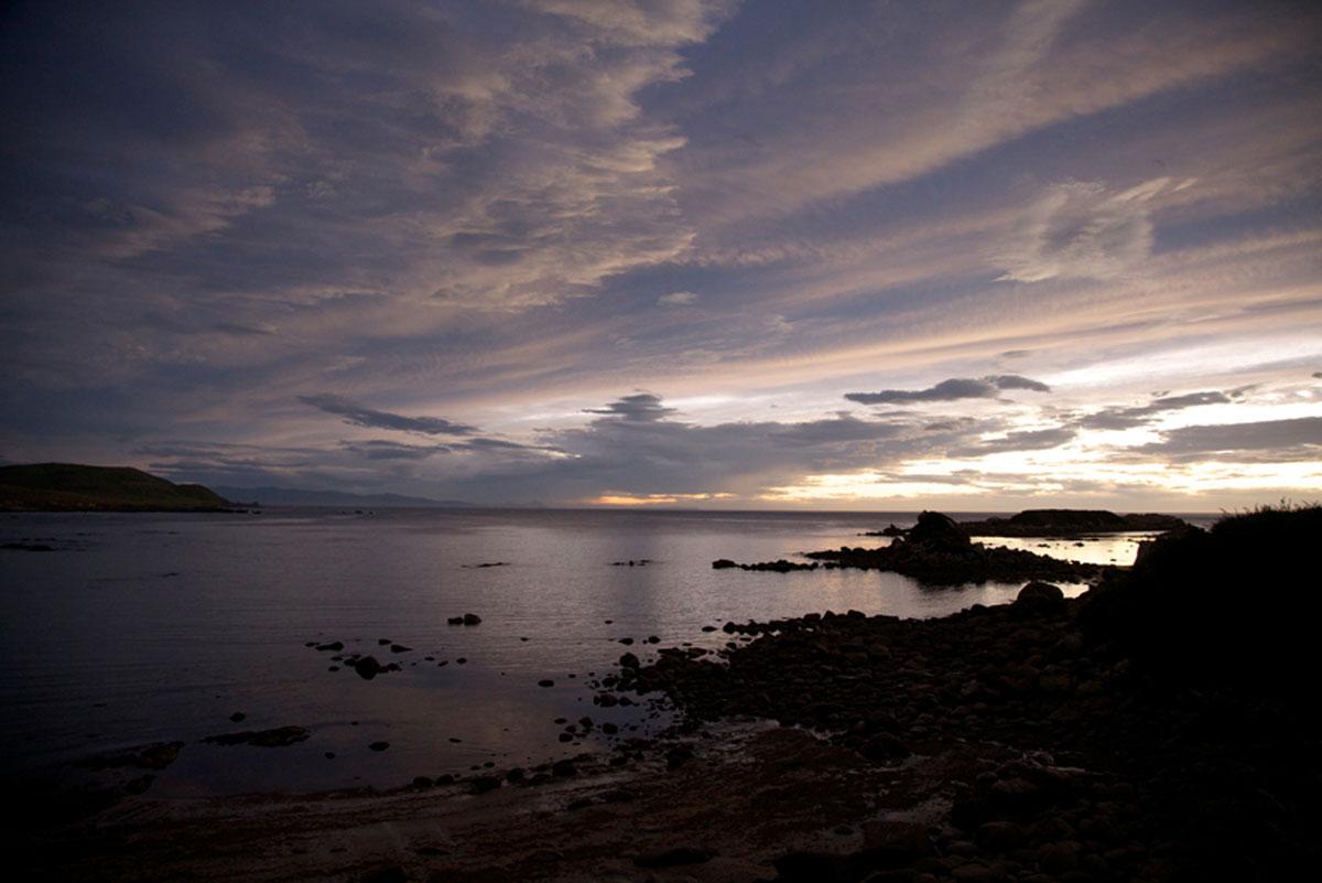 Pene Rock and Matariki Island at sunset